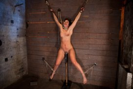 Wrist-suspension-while-impaled-on-a-cock-and-vibrator-Each-brutal-orgasm-weakens-and-further-impales